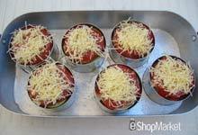 Menú de recetas: cubrimos la Musaka con el queso Emmental rallado para gratinarlas